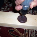 drill furniture coasters onto spots where the bedframe will rest