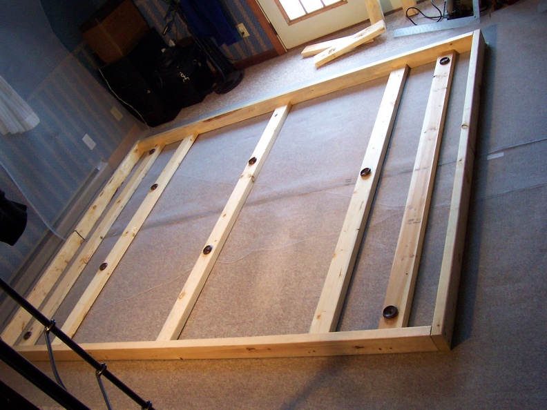 Lay two sections of wire mesh side by side underneath the wooden frame.JPG