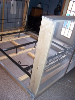 Place the bedframe on top of the wooden bottom frame